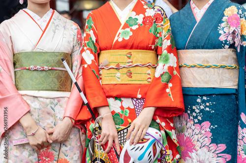 Valokuvatapetti Young girl wearing Japanese kimono standing in front of Sensoji Temple in Tokyo, Japan