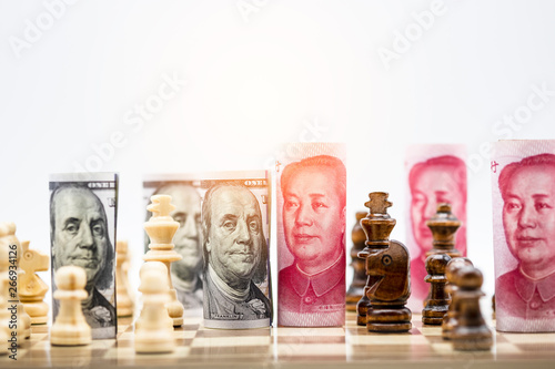 Photo  US dollar and Yuan banknote with chess for tariff trade war between United States and China which both countries battle by increase tax barrier of import and export product
