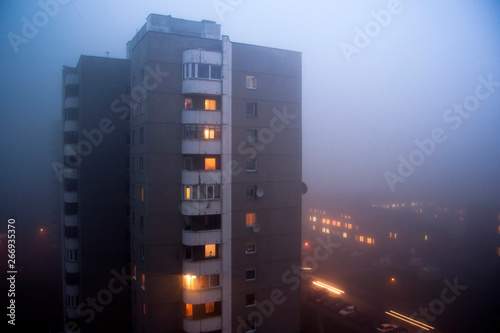 In de dag Oost Europa Building from soviet union time in morning evning fog