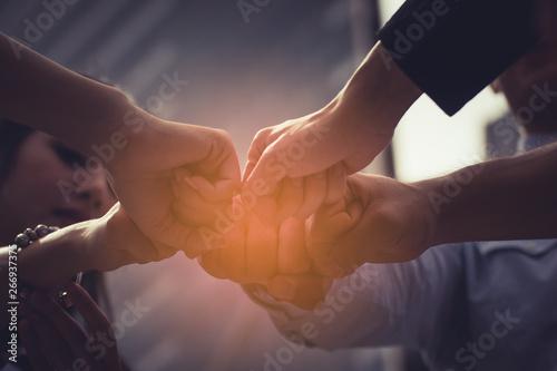 Cuadros en Lienzo Business people joining hands