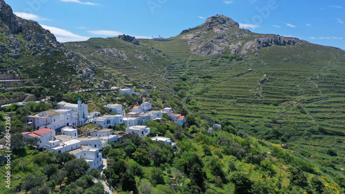 Foto auf Gartenposter Khaki Aerial drone photo of picturesque traditional village of Koumaros in the slopes of mountain and castle of Exomvourgo or Exombourgo with beautiful deep blue sky, Tinos island, Cyclades, Greece