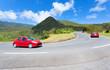 Voiture rouge sur route des Plaines, île de la Réunion