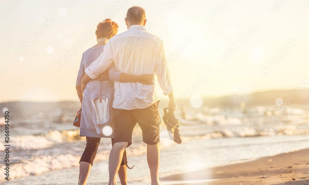 Fototapety, obrazy: Close-up portrait of an elderly couple hugging on seacoast