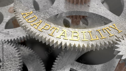 Photo The inscription ADAPTABILITY on the gear of the clock mechanism, 3d illustration