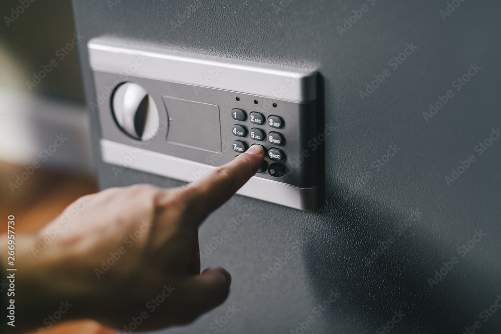 Fototapety, obrazy: man opens safe, combination lock
