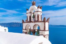 Traditional Old Bell Tower Against Blue Sea In Oia, Santorini, Greece