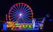 Leinwandbild Motiv Riesenrad mit Lichtern auf dem Jahrmarkt