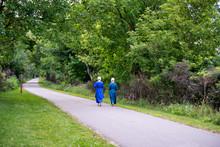 Amish Girls Walking On Bike Tr...