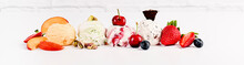 Sweet Ice Cream In Balls On A White Background. Dessert With Different Flavors And Fresh Berries. Copy Space.
