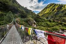 Mountain Valley With Prayer Flags Across Bridge