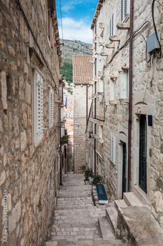 Fototapeten Schmale Gasse The beautiful steep alleys at the walled old town of Dubrovnik