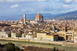 Amazing view on Florence city and its main cathedral dome (Santa Maria del Fiore dome). Awesome cityscape of Florence roofs, Italy. Florence from above, near observation deck. River arno and a dove.