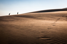 Children Hike A Sand Dune At G...