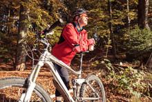 Man With Mountain Bike Having A Break In Forest