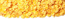 Cornflakes Dry Breakfast. Yellow Flakes In Bunch On Top Of Frame Isolated On White Background