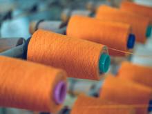 Spools Of Thread On Weaver Loom
