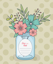 Mason Jar With Floral Decorations And Save Date Card