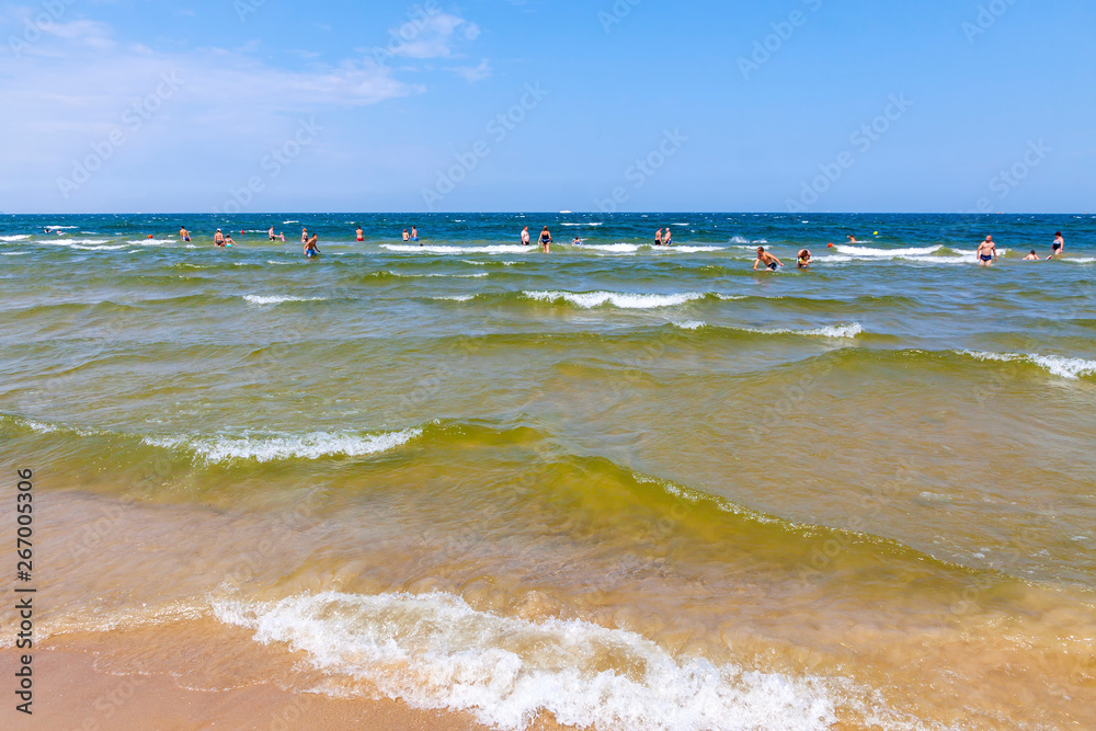 Fototapety, obrazy: Unrecognisable people relax on a Baltic sea beach on Usedom island in Swinoujscie city, Poland