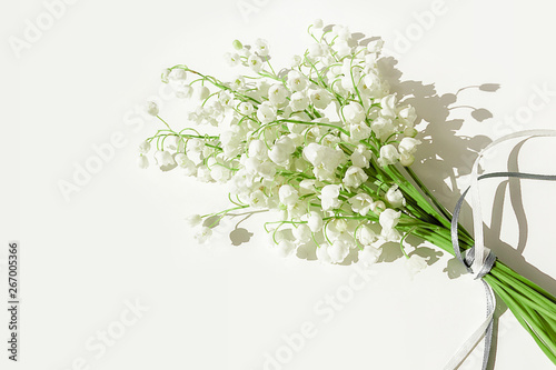 A bouquet of lilies of the valley on a white background. Isolated, selective focus, copy space.