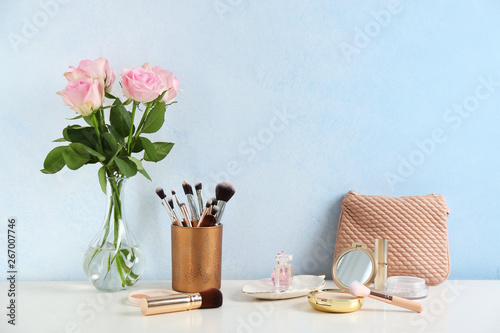 Photo Dressing table with beauty accessories in room. Space for text