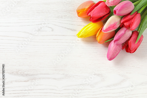 Beautiful spring tulip flowers on wooden background. Space for text