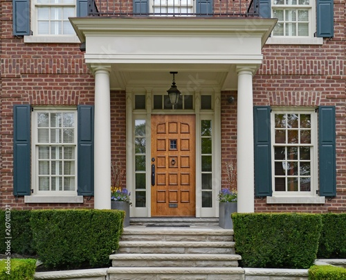 Front Of Elegantly Landscaped House With Stone Steps And