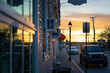 Storefront windows reflecting sunset, small town street, near harbor ocean