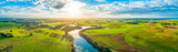 Aerial panoramic landscape of scenic sunset over river and grasslands in Australia