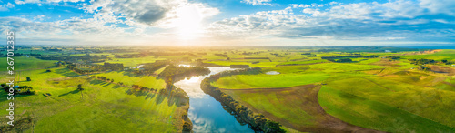 Obraz Aerial panoramic landscape of scenic sunset over river and grasslands in Australia - fototapety do salonu