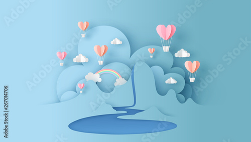 Photo Abstract of nature landscape view scene with cloud, pond, rainbow and heart shape hot air balloons float up on sky