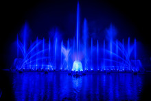 The Colorful Fountain Dancing In Celebration Festival With Dark Night Sky Background.