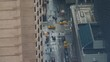 TIMELAPSE, CLOSE UP: Cool shot of a busy road junction on a rainy day in New York. Cars drive down the wet road and past pedestrians on the sidewalks in New York. People cross a busy road in Manhattan