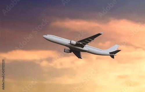 Photo  Passenger airplane flying during sunset
