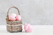 Wicker basket with Easter eggs and ceramic rabbit figure