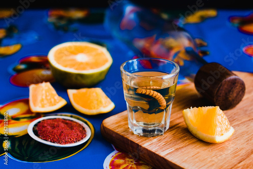 Fotografie, Obraz mezcal shot with chili salt and agave worm, mexican drink in mexico