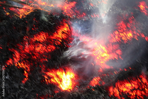 Fire sparks black background, burn effect, burning fire and smoke, sparks fire background Wallpaper Mural
