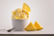 Leinwandbild Motiv Composition of pineapple ice cream ball in paper cup
