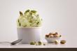 Leinwandbild Motiv Composition of pistachio ice cream ball in paper cup