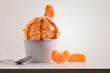 Leinwandbild Motiv Composition of tangerine ice cream ball in paper cup