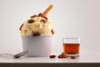 Leinwandbild Motiv Composition of raisins ice cream ball in paper cup