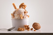 Leinwandbild Motiv Composition of walnuts ice cream ball in paper cup