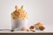 Leinwandbild Motiv Composition of almond ice cream ball in paper cup