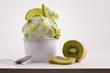 Leinwandbild Motiv Composition of kiwi ice cream ball in paper cup