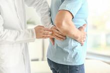 Urologist Examining Male Patie...