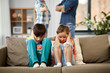 Leinwandbild Motiv family problem, conflict and people concept - sad children closing ears while their parents quarreling at home