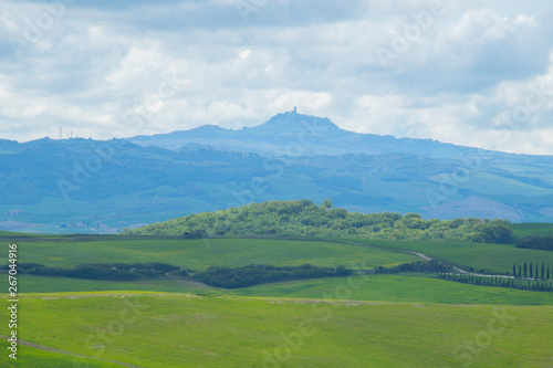 Poster Pool The landscape of Val d'Orcia with Radicofani fortress in the background. Hills of Tuscany. Val d'Orcia landscape in spring