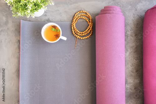 Open yoga mat and bolster for practice, wooden mala beads for metitation , Ayurveda tea for relax