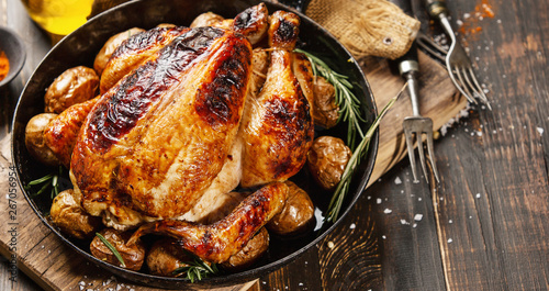 Baked whole chicken with spices on pan - 267056954