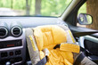canvas print picture - Empty child safety seat in car mounted in the front seat