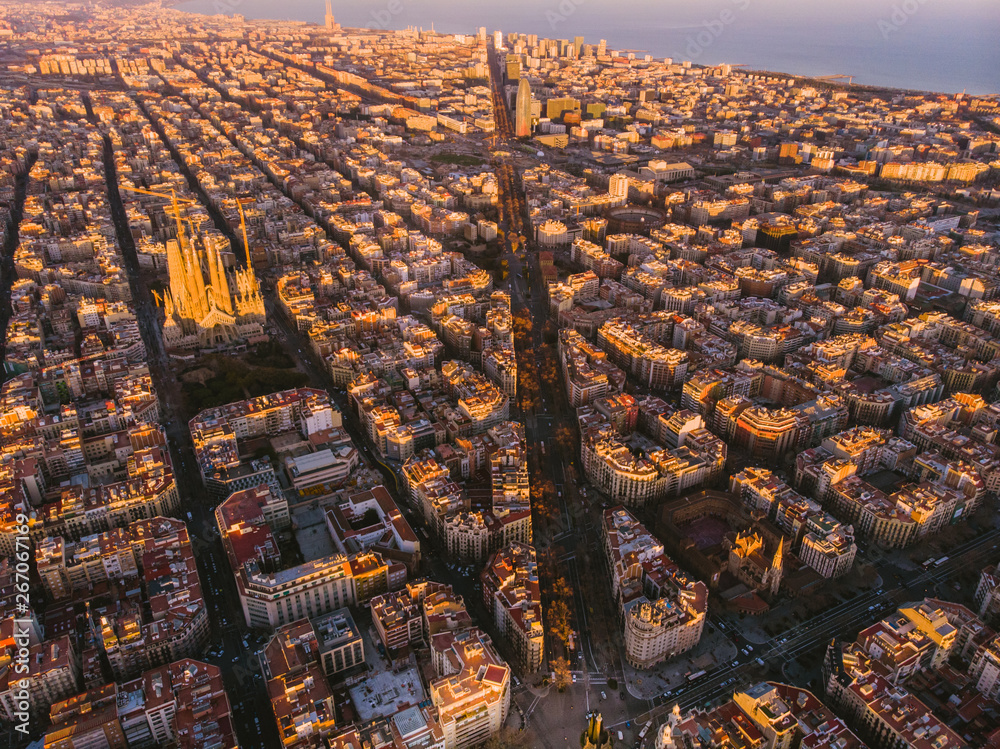 Fototapeta Sagrada Familia cathedral and Barcelona cityscape in Spain, aerial view.